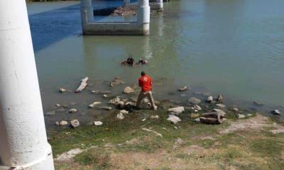 Intentan mujeres cruzar nadando llevaban niño